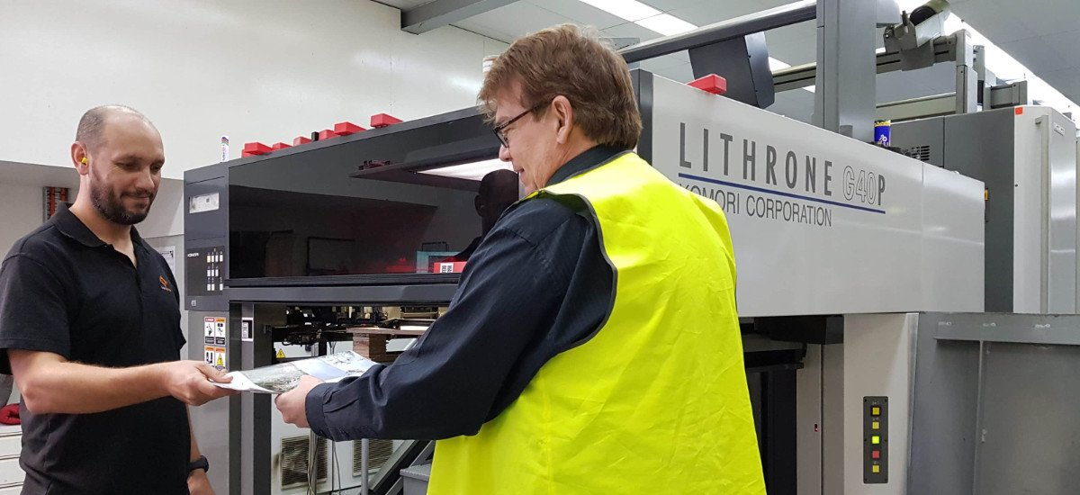 staff at Alpha Mail using industrial printer